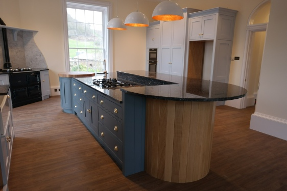 Bespoke hand made painted kitchen with curved cupboards