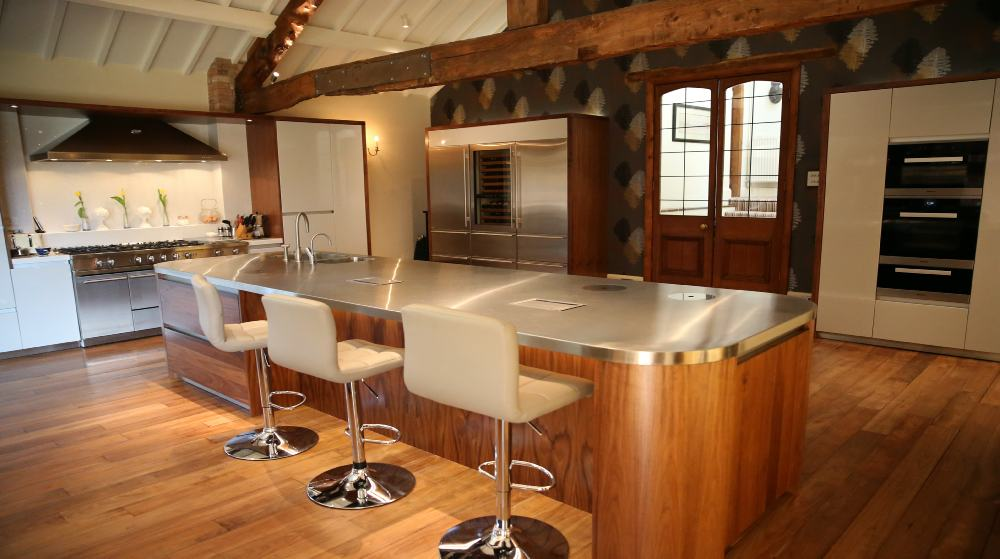 Bespoke walnut and painted kitchen with Sub Zero fridges, Miele appliances and stainless steel worktops